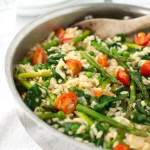 Risotto with Spinach, Asparagus, Peas, and Tomatoes | tamingofthespoon.com