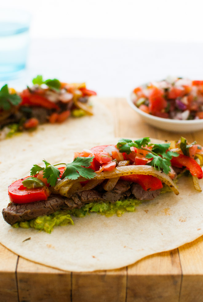 Beef Fajitas - Skirt steak marinated in lime juice, jalapeños, and cilantro make for the juiciest and most tender beef fajitas. | tamingofthespoon.com