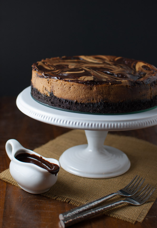 Cappuccino Marble Cheesecake with Fudge Sauce - A rich cheesecake with swirls of cappuccino and chocolate (but made with low fat cream cheese) from tamingofthespoon.com