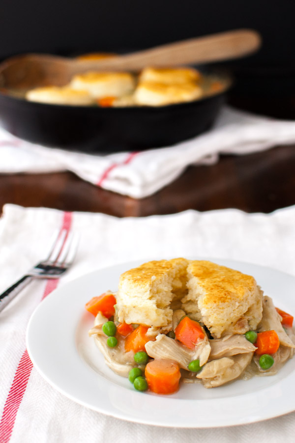 Chicken pot pie - a creamy filling of chicken and vegetables topped with flaky biscuits. | tamingofthespoon.com