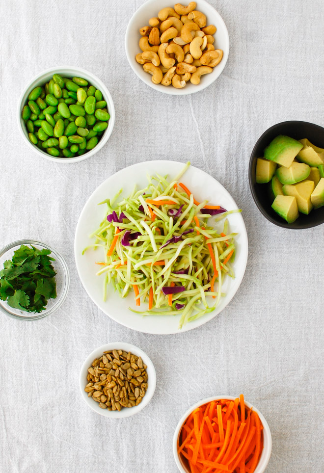 This tasty salad has everything for a delicious and healthy meal - broccoli slaw, shredded carrots, shredded cabbage, nuts, sunflower seeds, crunchy ramen noodles and an Asian inspired dressing. | tamingofthespoon.com