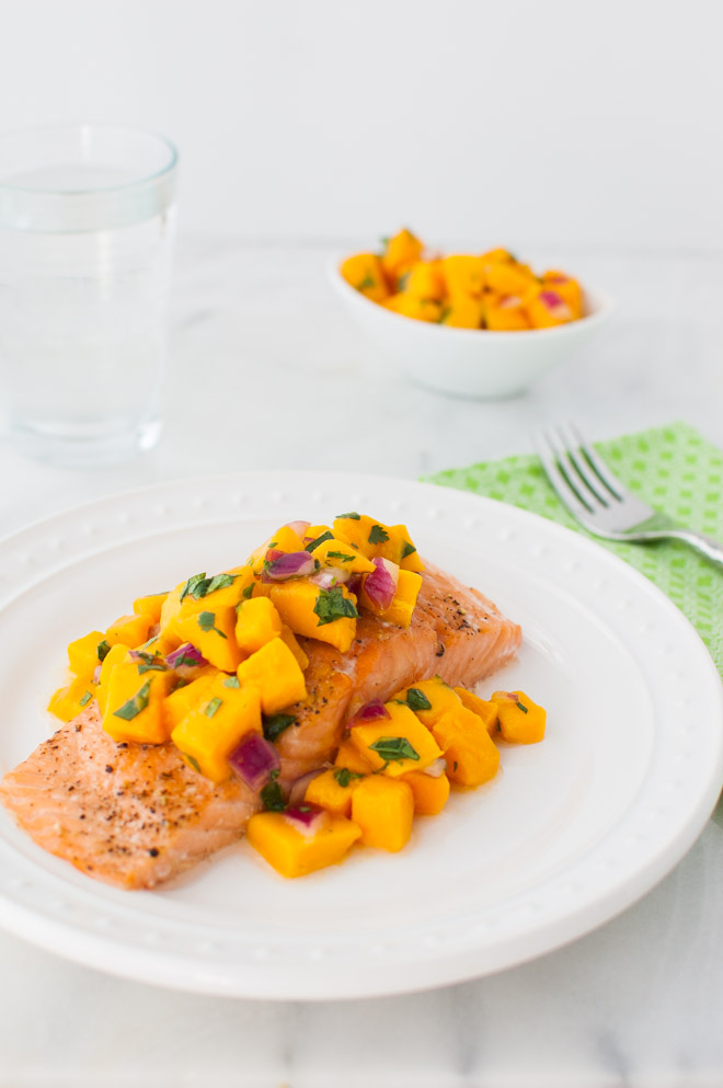 Roasted Salmon with Mango Salsa - Oven roasted salmon topped with a bright, sweet, and spicy mango salsa. | tamingofthespoon.com