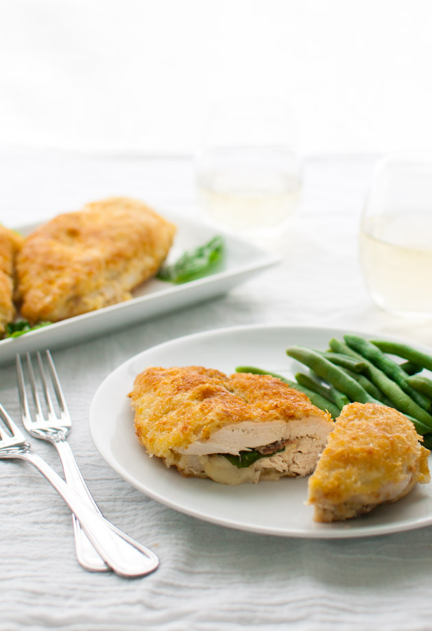 Stuffed chicken breasts with prosciutto, basil, and cheese and coated ...