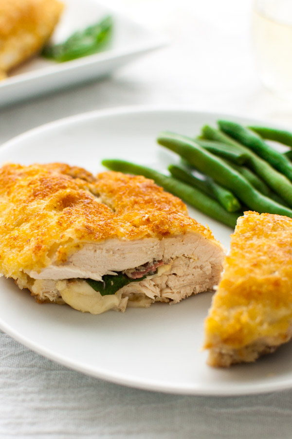Stuffed chicken breasts with prosciutto, basil, and cheese and coated in crispy panko breadcrumbs and Parmesan cheese. | tamingofthespoon.com
