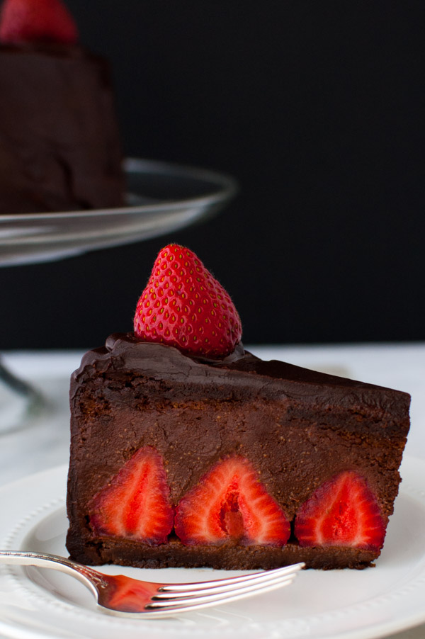 Chocolate Strawberry Mousse Cake - Chocolate cake filled with fresh strawberries and chocolate strawberry mousse and covered in chocolate ganache. | tamingofthespoon.com