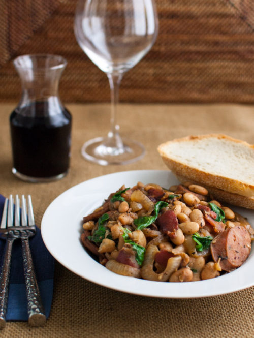 White Bean Stew with Bacon, Sausage, and Spinach | tamingofthespoon.com