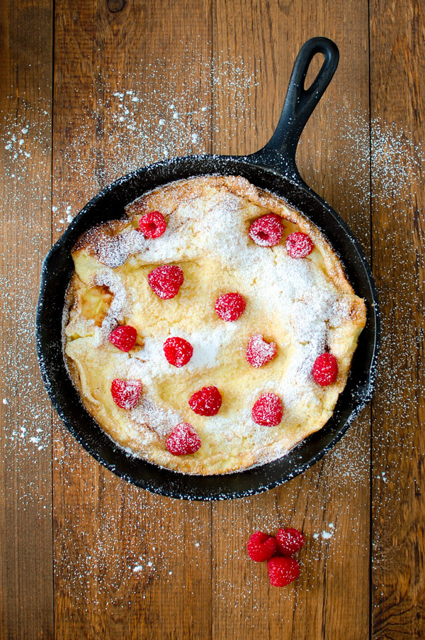Pear Dutch Baby Pancake - a puffy German pancake with pears and powdered sugar from tamingofthespoon.com