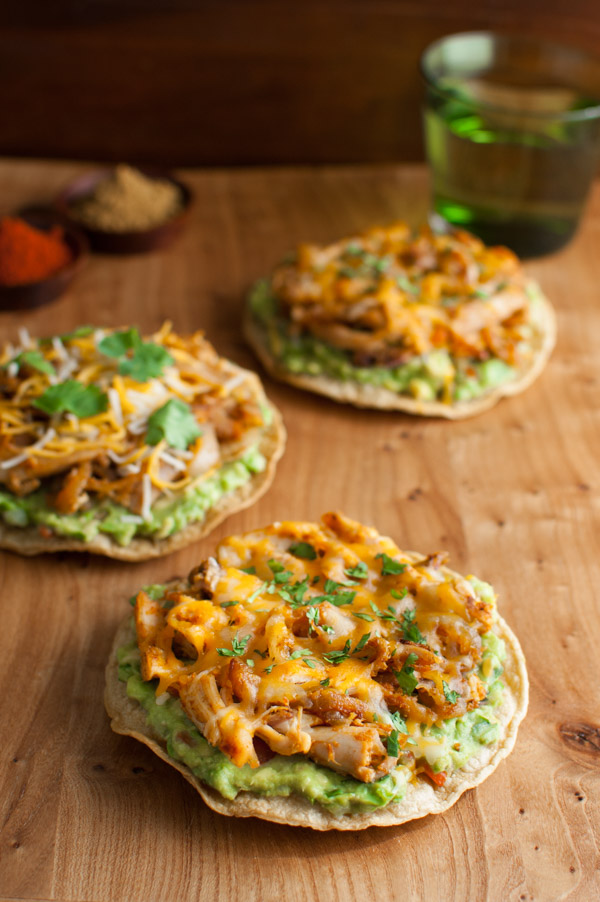 Easy and healthy tostadas using baked corn tortillas and rotisserie chicken spiced with cumin and paprika. | tamingofthespoon.com
