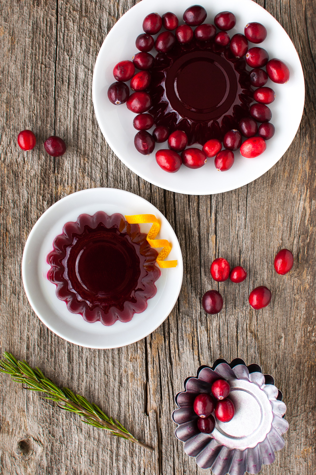Overhead view of cranberry jelly molds on plates.