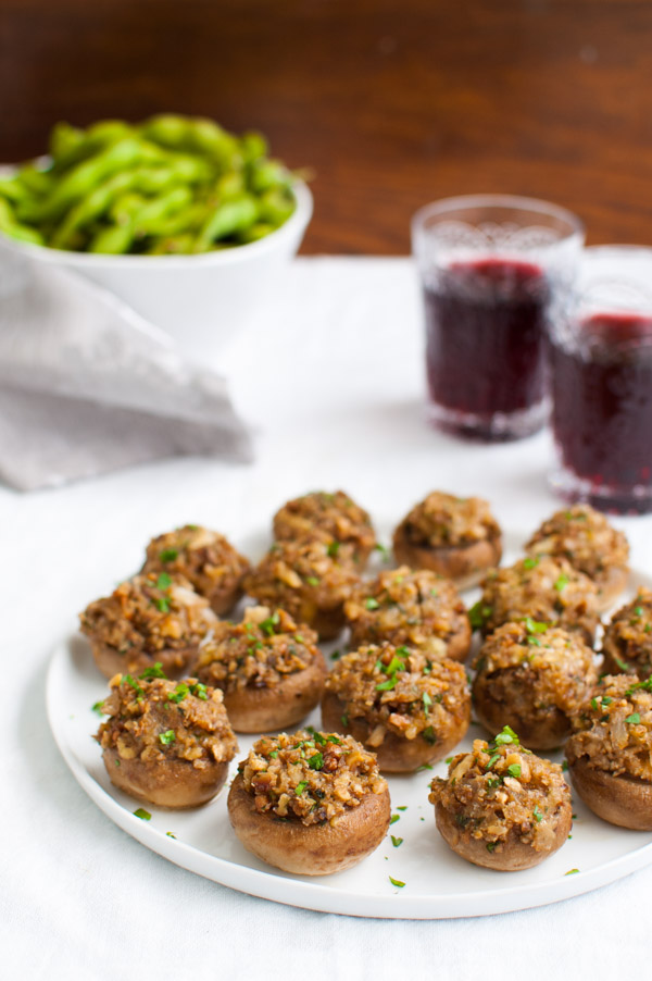 Mushrooms stuffed with cheddar cheese, walnuts, onions, and bread crumbs from tamingofthespoon.com