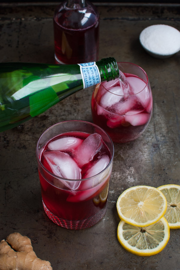 Hibiscus Ginger Tea Spritzer - A refreshing non-alcoholic drink made with hibiscus tea, fresh ginger, lemon juice, and sparkling water. Perfect for any party from tamingofthespoon.com