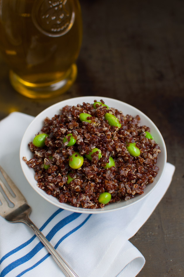 Hearty red quinoa mixed with edamame and olive oil. Simple yet delicious from tamingofthespoon.com