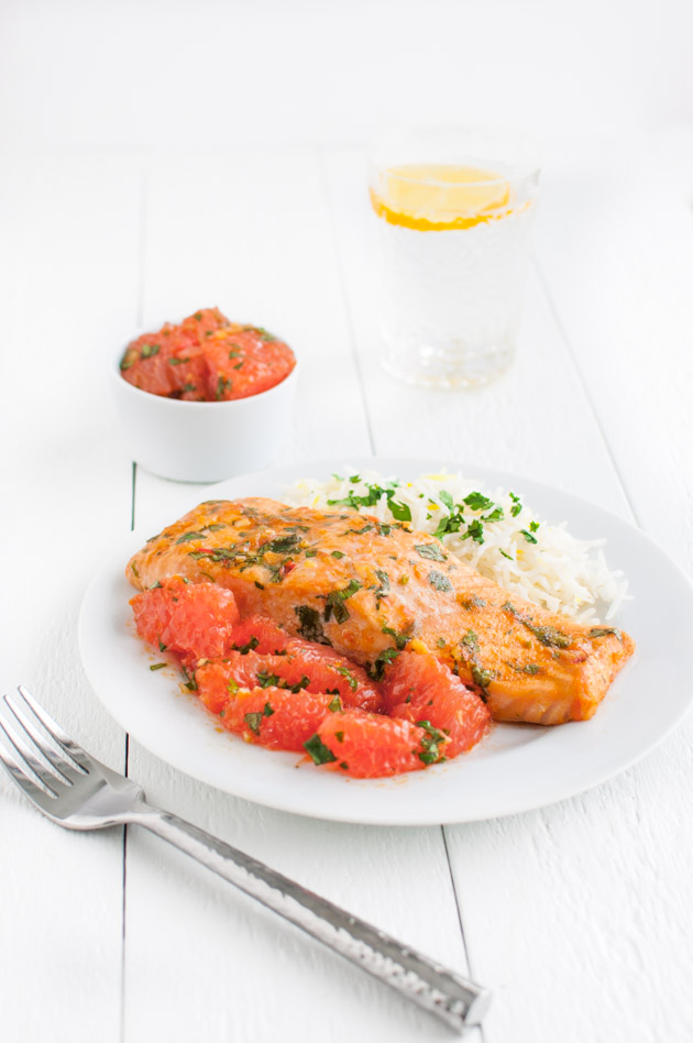 Salmon with Moroccan Grapefruit Chermoula - Roasted salmon topped with a Moroccan spiced sauce of grapefruit segments, lemon juice, harissa paste, cilantro, and spices from tamingofthespoon.com