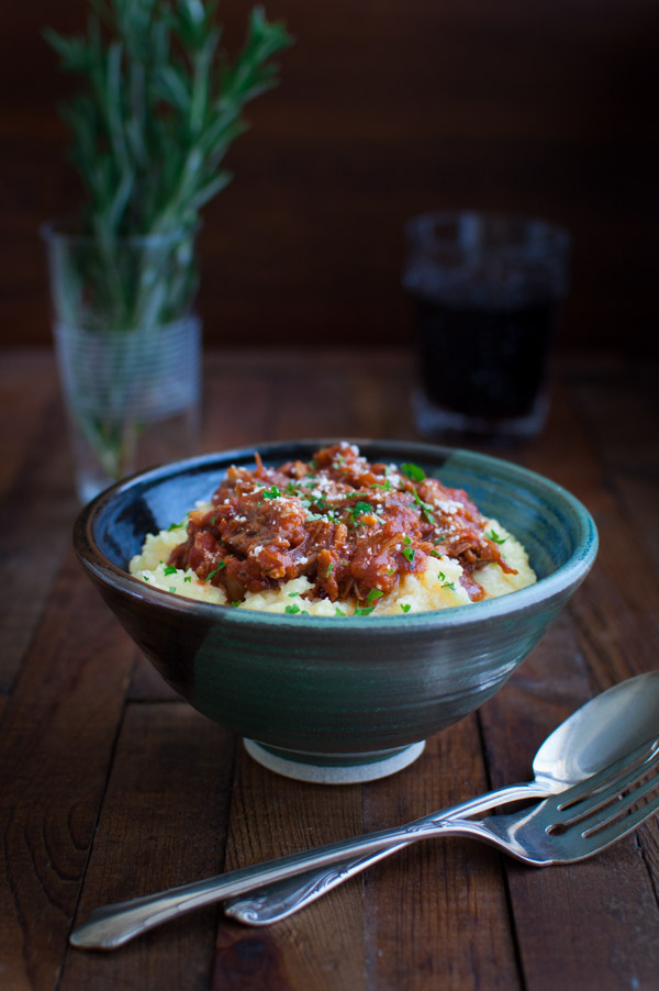 Pork Ragu with Easy Microwave Polenta - tender, braised pork in a rich tomato sauce over easy to make creamy polenta from tamingofthespoon.com