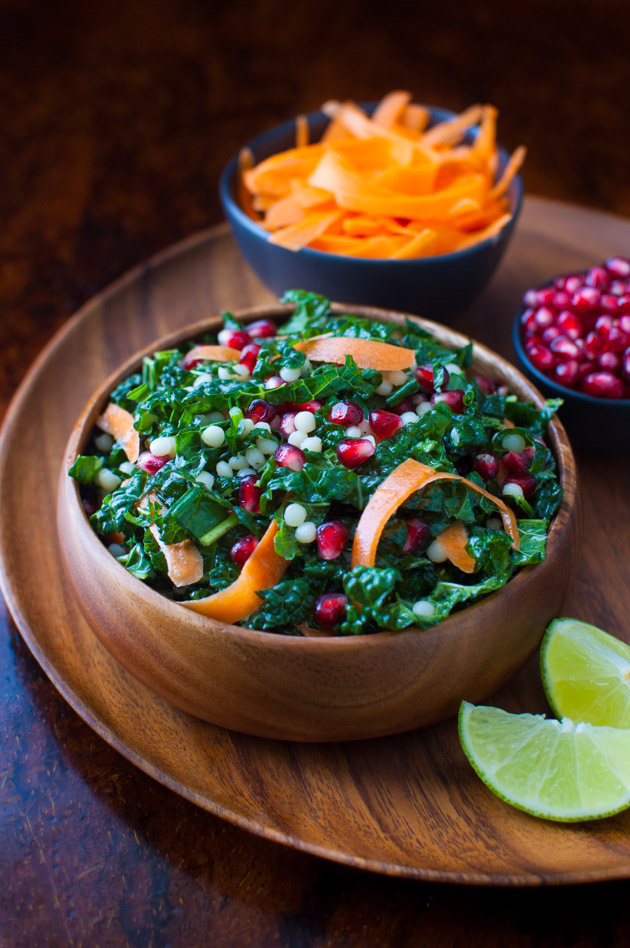 Pomegranate, Israeli Couscous, Carrot and Kale Salad with Honey-Lime Vinaigrette - a light and healthy kale salad with punches of flavor from pomegranate seeds and a zesty honey-lime vinaigrette. | tamingofthespoon.com