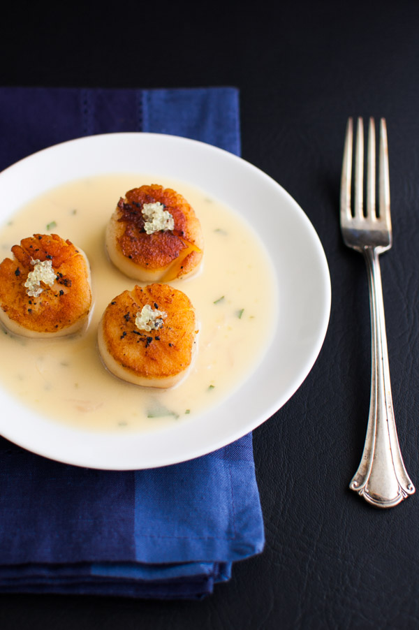Seared Scallops with Finger Lime Beurre Blanc - Perfectly seared scallops in a rich butter sauce made with finger (caviar) limes, tarragon, white wine, and butter. | tamingofthespoon.com