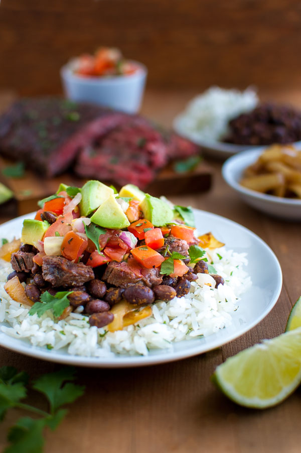 Beef Burrito Rice Bowls - everything you need for a fabulous low-fat meal in one bowl - rice, beans, avocados, pico de gallo, and the most flavorful skirt steak you've ever tasted. | tamingofthespoon.com