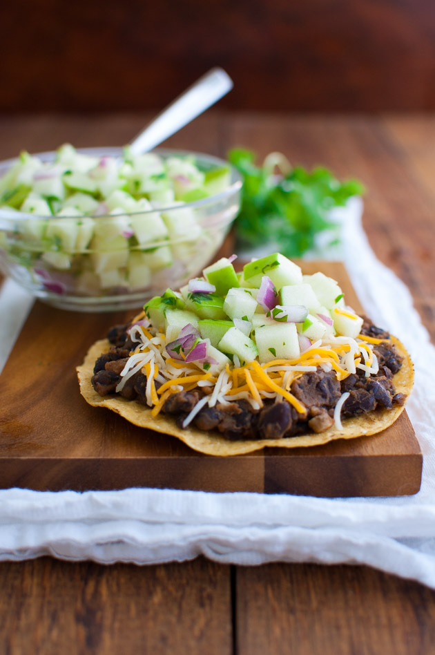 Black Bean Tostadas with Green Apple Salsa - A great vegetarian dish with seasoned black beans and a sweet-tart salsa made with Granny Smith apples. | tamingofthespoon.com