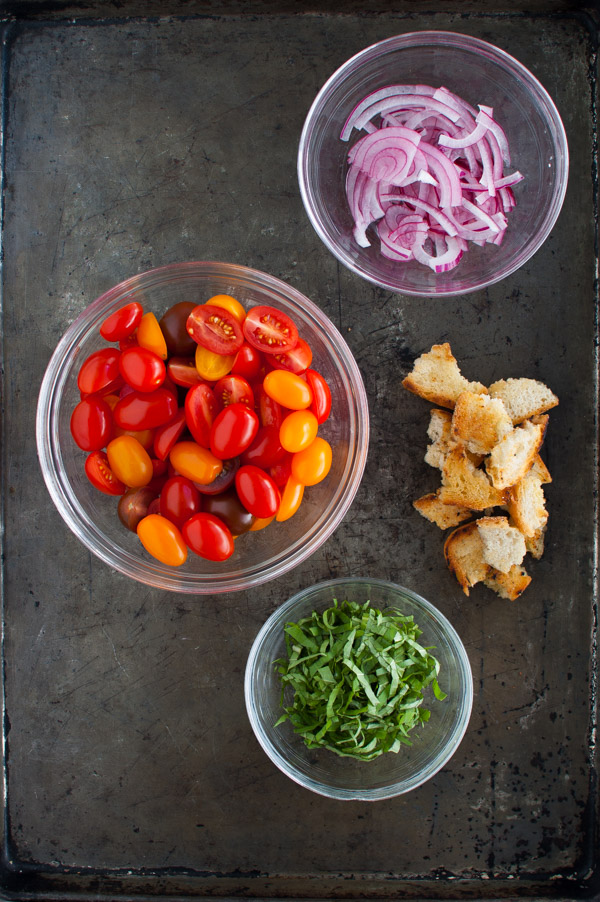 Prosciutto Wrapped Chicken Cutlets with Cherry Tomato Panzanella - Cherry tomatoes get a quick sauté before being tossed with toasted bread pieces, vinegar, and olive oil then served with seared prosciutto wrapped chicken cutlets. | tamingofthespoon.com