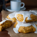 Pumpkin Scones with Vanilla Glaze - These scones don't require any kneading, rolling, or cutting. They get scooped out with an ice-cream scoop for a mess free morning treat.| tamingofthespoon.com