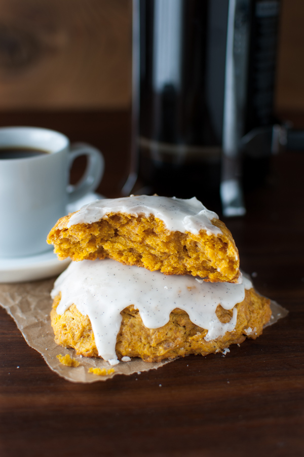 Pumpkin Scones with Vanilla Glaze - These scones don't require any kneading, rolling, or cutting. They get scooped out with an ice-cream scoop for a mess free morning treat. | tamingofthespoon.com