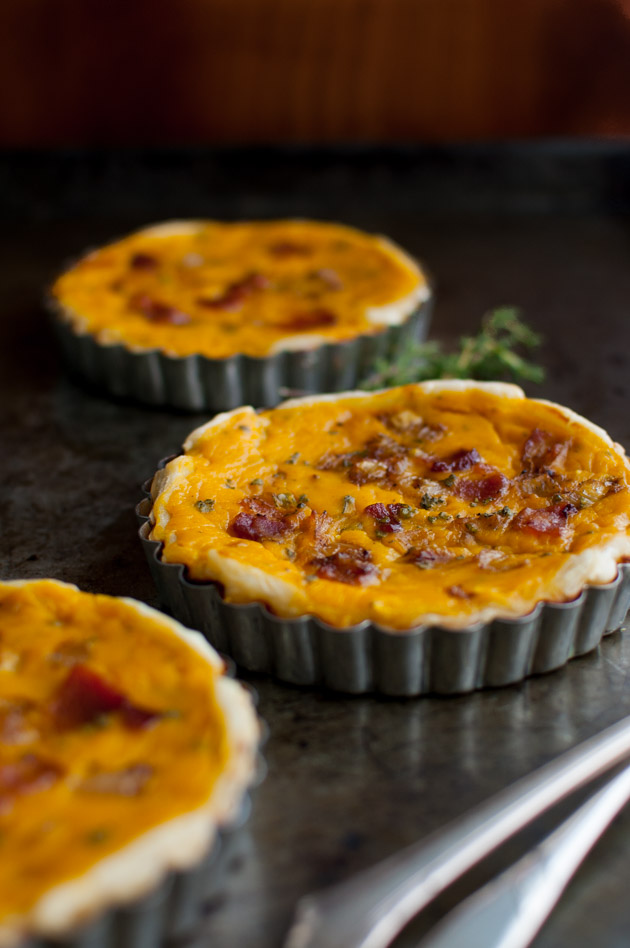 Winter Squash Tart with Bacon, Caramelized Onions, and Herbs - a savory tart that is easy to make thanks to frozen puff pastry and frozen winter squash purée. All the the taste of fall with less work. | tamingofthespoon.com