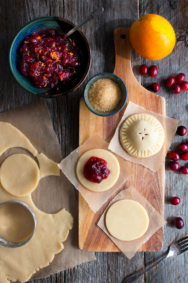 Cranberry Orange Hand Pies - a sweet-tart cranberry orange filling inside the most tender pie crust. | tamingofthespoon.com