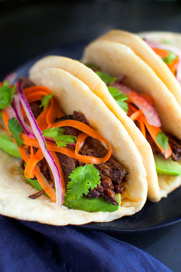 Korean Beef Tacos - These beef tacos are juicy, super tender and so easy to make in the slow-cooker. A tangy carrot and red onion slaw is the perfect balance for the sweet-smoky flavor of the beef. | tamingofthespoon.com