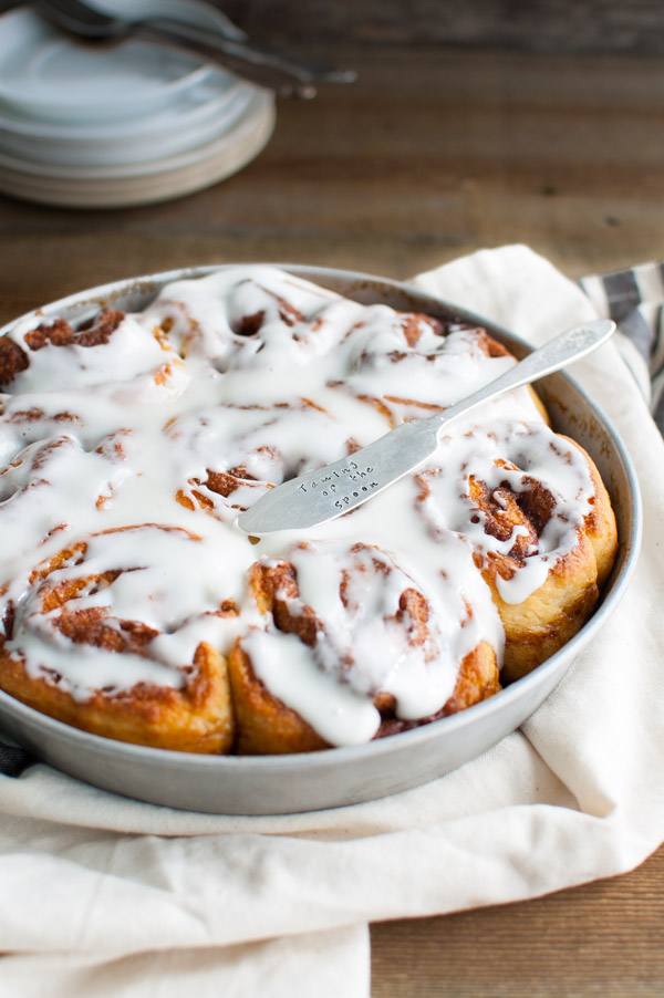 Quick Cinnamon Rolls - These cinnamon rolls are as tender and tasty as standard yeast based rolls but so much quicker to make since it uses buttermilk and baking powder. You can have fresh hot rolls (made from scratch) on your table in less than an hour! | tamingofthespoon.com