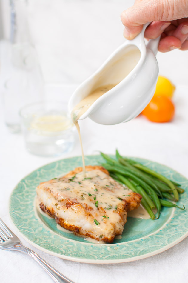 Pan Fried Fish with Citrus Butter Sauce - Fish fillets lightly battered and pan-fried then served with a zesty citrus butter sauce. | tamingofthespoon.com