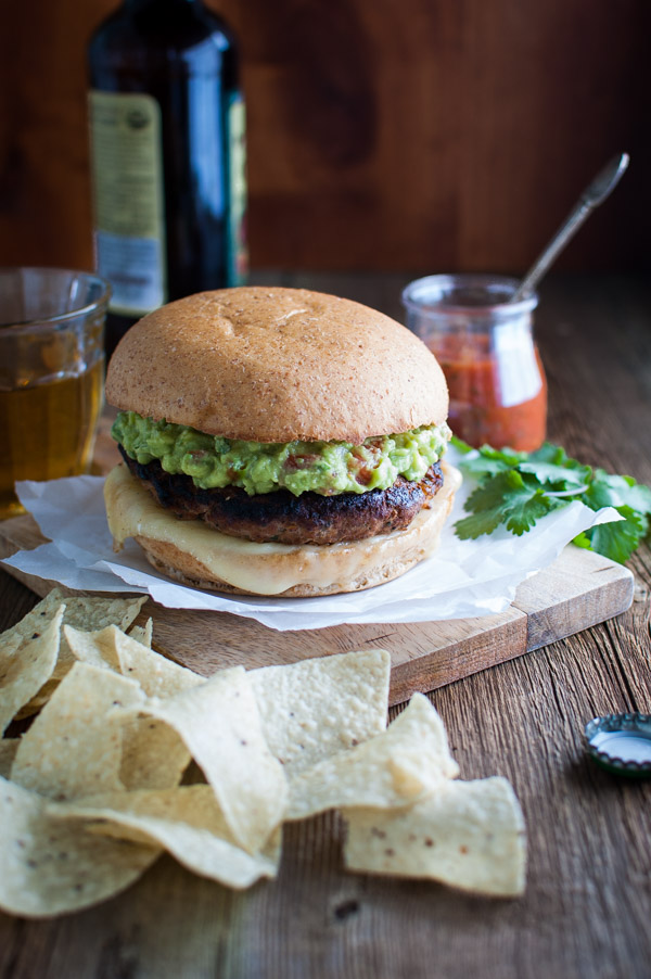 Salsa Turkey Burgers - Salsa mixed into the patties adds tons of flavor and makes these turkey burgers rival any beef burger without the extra fat and calories. | tamingofthespoon.com