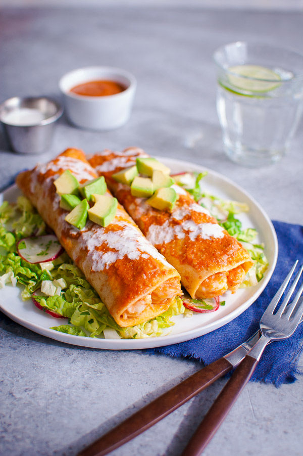 Shrimp Enchiladas with Napa Slaw - Enchiladas filled with shrimp and homemade chipotle sauce served with a napa cabbage and radish slaw for crunch. | tamingofthespoon.com