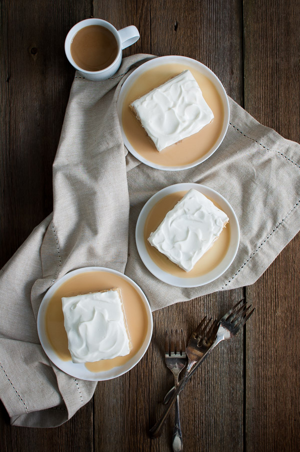 Tres Leches Cake - a sponge cake soaked with a sweet milk mixture of evaporated milk, sweetened condensed milk, and cream. This recipe also uses cajeta, a caramelized goat's milk spread. | tamingofthespoon.com