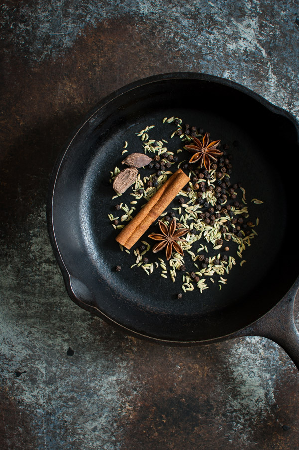 Skillet of spices for making pho - star anise, cardamom, fennel, peppercorns, and cinnamon