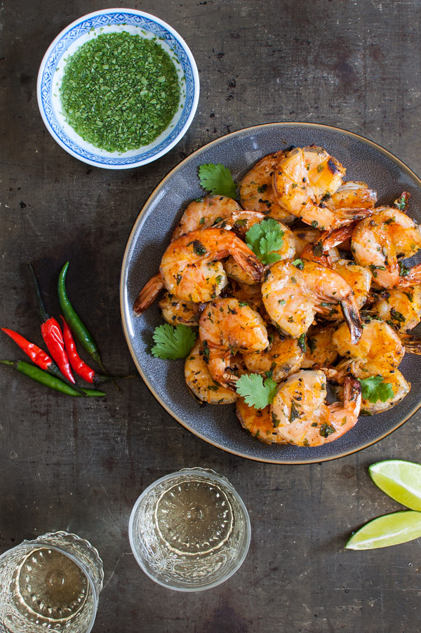 Thai Grilled Shrimp with Angry Sauce - these peel and eat shrimp get marinated in a fabulous Thai marinade of garlic, paprika, black sesame seeds, and orange peel. The dipping sauce complements the grilled shrimp perfectly. | tamingofthespoon.com