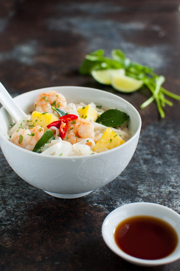 Thai Shrimp Soup - This fragrant Thai soup gets its authentic flavor from kaffir lime leaves and fish sauce. Pineapples and shrimp keep this soup light and refreshing for enjoying year round. | tamingofthespoon.com