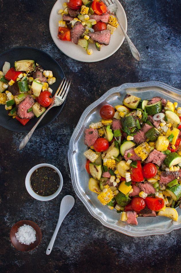 Marinated Skirt Steak and Grilled Vegetables Salad - Skirt steak gets marinated in a basil balsamic vinaigrette that doubles as a dressing for the grilled vegetables salad. Perfect for summer grilling.  | tamingofthespoon.com