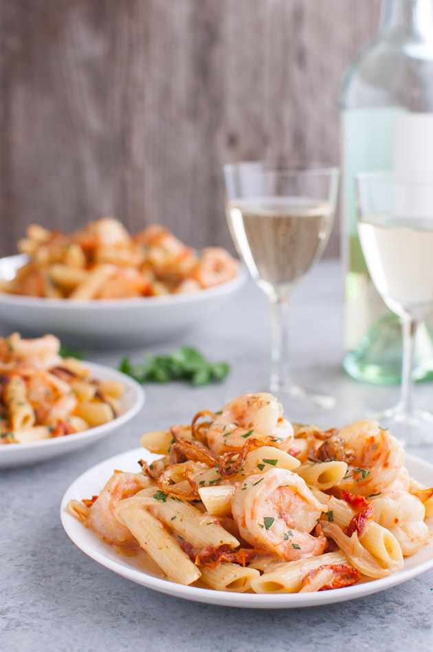 Pasta with Shrimp, Shallots, and Sun-dried Tomatoes in Creamy Madeira Sauce - the delicious combination of pasta, shrimp, and sun-dried tomatoes is even better with the addition of shallots and madeira wine. | tamingofthespoon.com