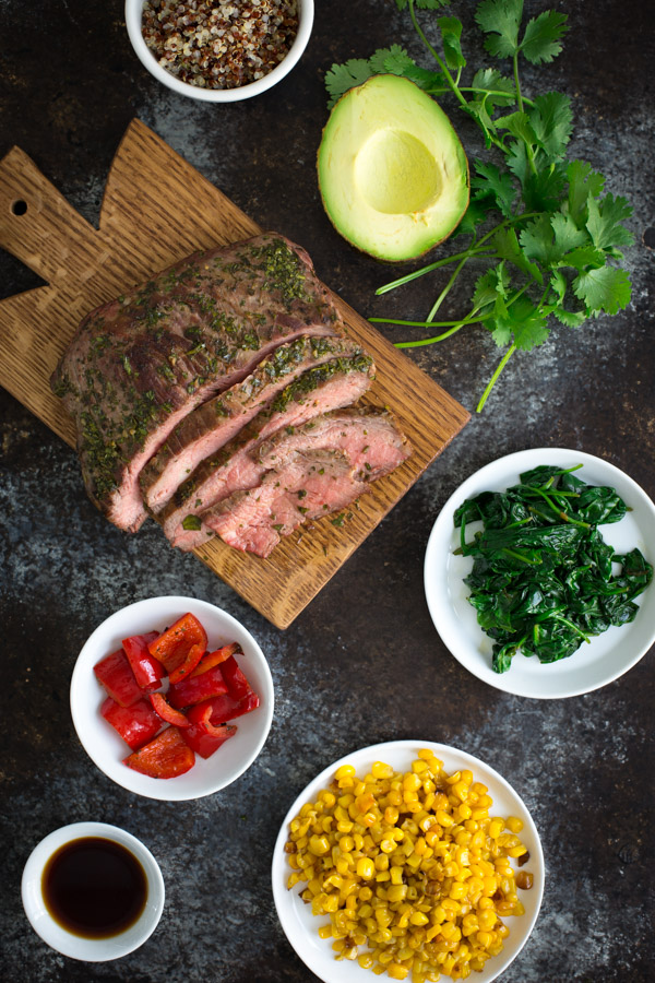 Chimichurri Steak and Quinoa Bowls - thinly sliced chimichurri steak and lots of sautéed vegetables are piled high on top of quinoa for a healthy weeknight meal. A drizzle of ponzu sauce ties all the flavors together. | tamingofthespoon.com