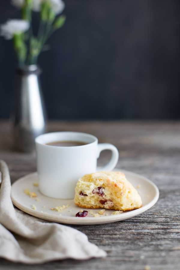 Dried Cranberry Scones - Light and tender scones studded with dried cranberries and fresh orange zest. Perfect on their own or with some sweetened whipped cream. | tamingofthespoon.com