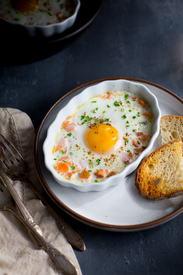 Baked Eggs with Smoked Salmon and Chives - this elegant yet easy egg dish is simple enough for a weekday breakfast yet fancy enough to serve at weekend brunch for guests. | tamingofthespoon.com