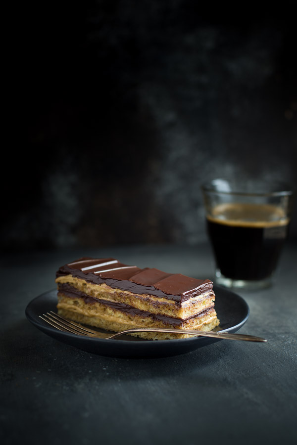 Opera Cake - the classic French cake consisting of layers of coffee syrup soaked almond sponge cake, coffee buttercream and chocolate glaze. | tamingofthespoon.com