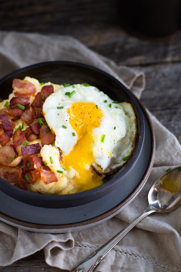 Cheese Grits Breakfast Bowls - Savor breakfast with creamy cheese grits (made in the microwave) and topped with bacon and a fried egg. | tamingofthespoon.com