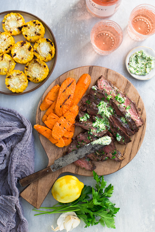 Spice-Rubbed Grilled Flap Steak with Parsley Garlic Lemon Butter - tender and flavorful as fancier cuts of meat but less expensive and easier to grill, flap steak will become your new favorite cut of beef. | tamingofthespoon.com