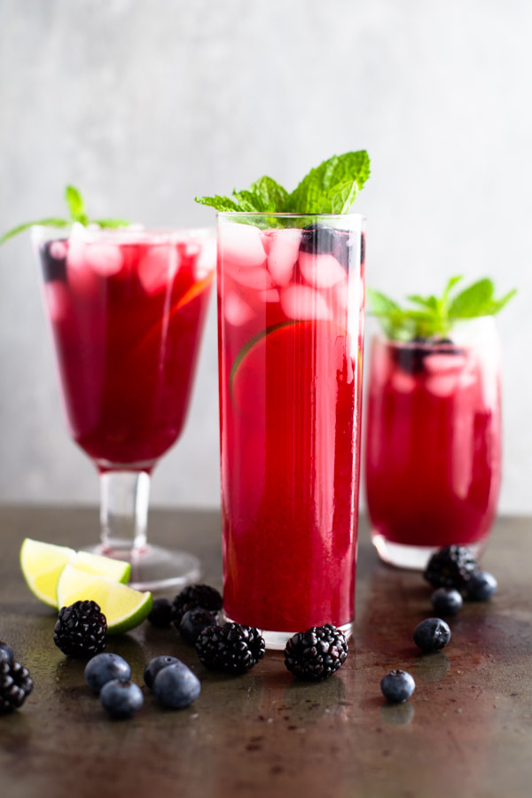 Blackberry-Blueberry Lemonade {or Limeade} - This easy lemonade recipe uses a homemade blackberry-blueberry simple syrup but bottled lemonade to save time. | tamingofthespoon.com