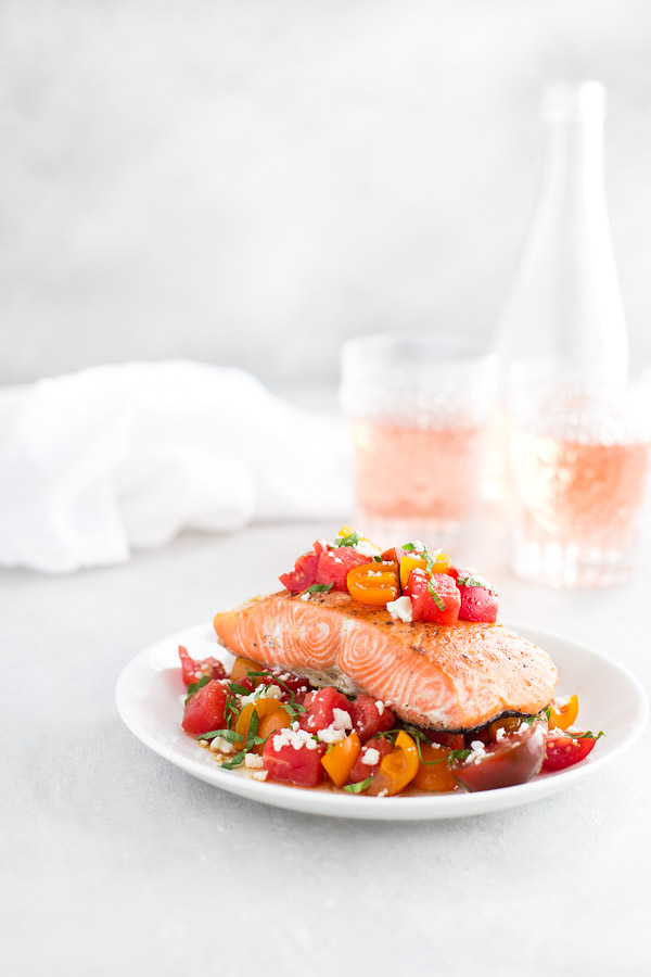Roasted Salmon with Tomato, Watermelon, Feta Salad - Savor the best of summer produce with this tomato, watermelon, feta salad served with roasted salmon. | tamingofthespoon.com