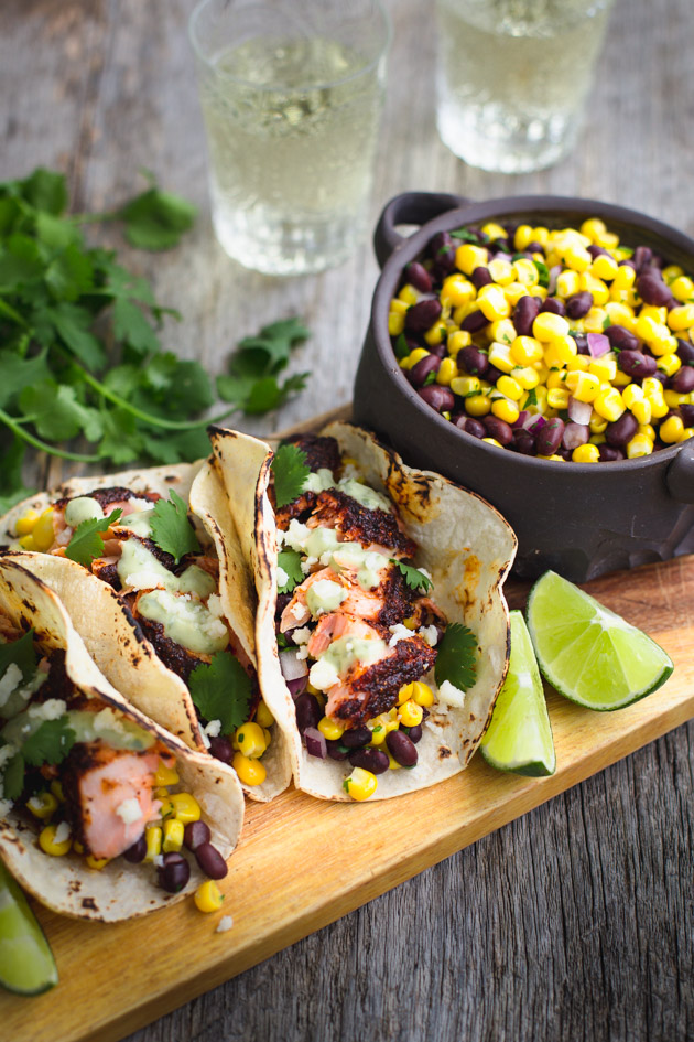 Blackened salmon topped with black bean and corn relish wrapped in warm tortillas and topped with creamy avocado sauce.