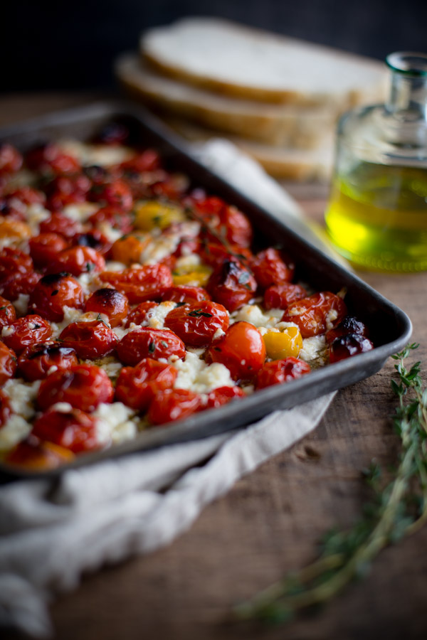 Roasted Tomatoes with Thyme and Feta - a quick and easy side dish that goes great with roasted chicken or can be used to make a delicious bruschetta. | tamingofthespoon.com