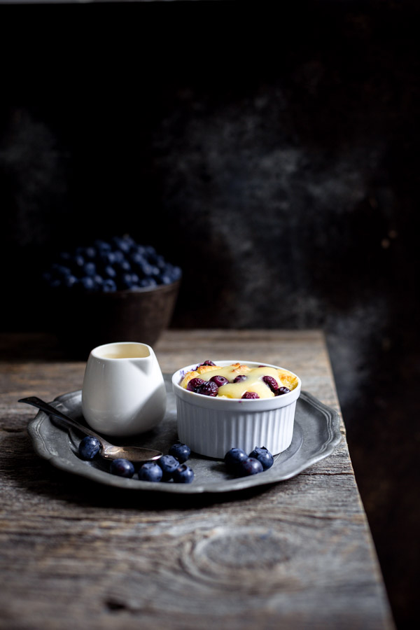 Blueberry Bread Puddings with Lemon Curd - individual bread puddings bursting with blueberry and lemon flavors. The perfect dessert for spring.