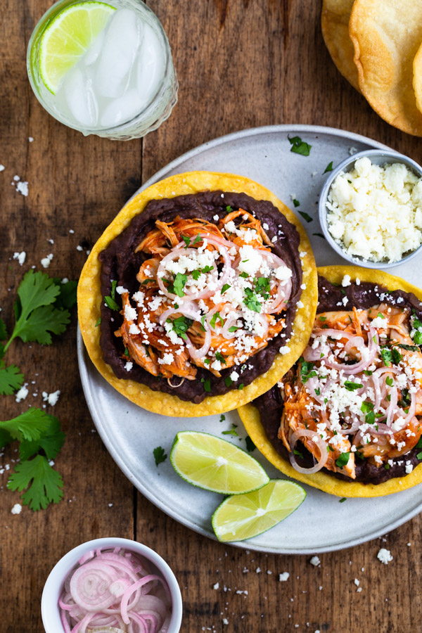 Easy Chicken Tinga Tostadas - Making these smoky chipotle chicken tostadas is super easy thanks to a few kithen hacks. You would never guess how easy they are given how delicious they taste! | tamingofthespoon.com